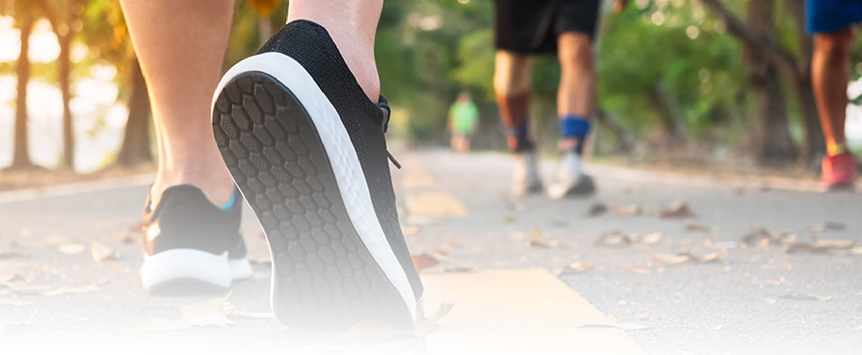 photo of feet walking and running on paved surface